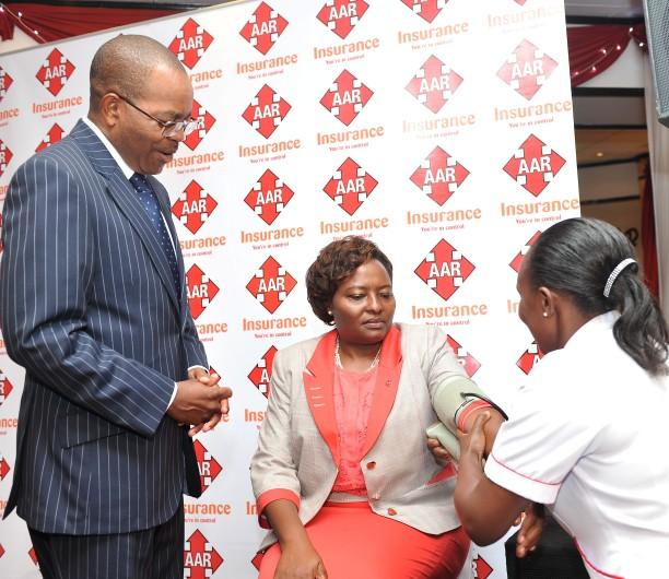 (L-R) Group CEO AAR Mr. Geoffrey Nzau, AAR Insuarance MD Caroline Munene And Nurse Veronica Nderitu