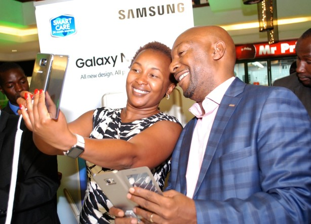 (L-R) Safaricom Director,  Consumer Business Unit Sylvia Mulinge and Samsung Electronic East Africa  Vice President and COO Robert Ngeru