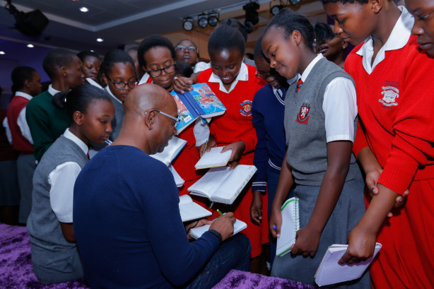 Bob Collymore, Safaricom CEO signs autographs for students during the launch of Technovation Challenge at Safaricom Headquarters, Nairobi.