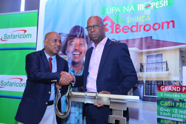 Safaricom Limited CEO Bob  Colleymore presents a house key to Mr. Salim Nassib Mbarak from Mombasa who  is the third and last lucky winner of the Lipa Na Mpesa Shinda 3-Bedroom  house promotion.