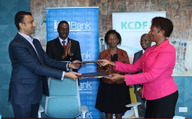 I&M Bank Executive Director Mr. Sarit Raja-Shah (left) exchanging document with the Kenya Community Development Foundation (KCDF) Board Chairperson Ms. Eunice Mathu after I&M Bank Foundation and KCDF signed a partnership on environmental conservation.